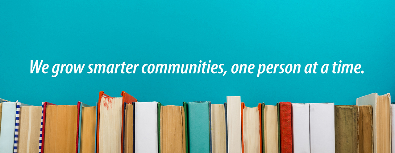 "Graphic with stack of books captioned ""We grow smarter communities, one person at a time."""