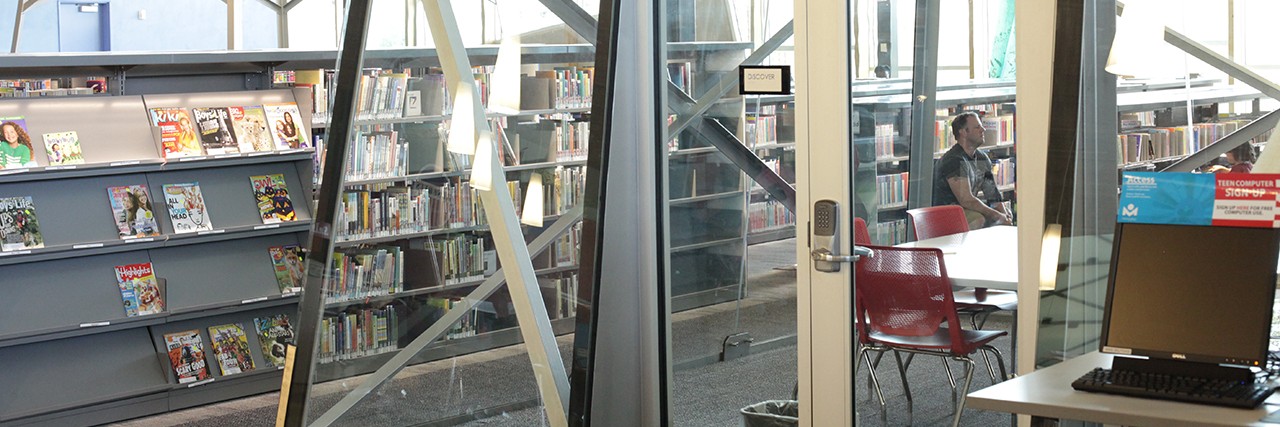 Reserve a Room header image showing a reservable room amid bookstacks with glass walls