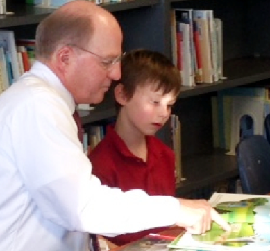 Ward Reading to a Child