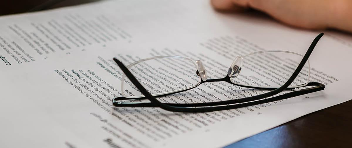 Pair of glasses on document