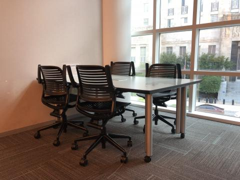 Study Room B with small rectangular table and four chairs