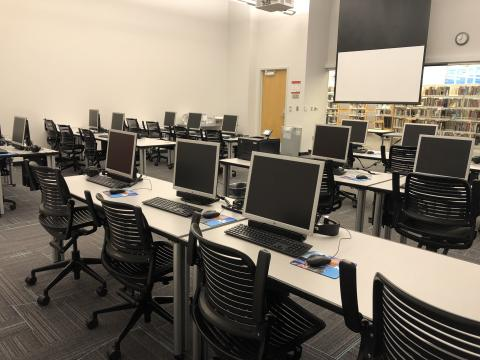 Route 66 Computer Lab with rows of computers and large screen