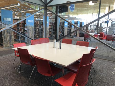 Explore Room at the Northwest Library with square table and ten chairs
