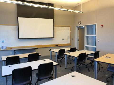 Classroom F with classroom-style seating and large screen at front